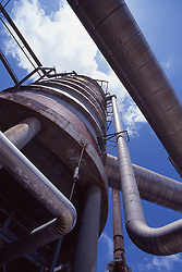 Stock photo of an upward view of a storage tank at a chemical plant