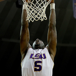 December 29, 2011; Baton Rouge, LA; LSU Tigers forward Malcolm White (5) dunks against the Grambling State Tigers during the second half of a game at the Pete Maravich Assembly Center.  LSU defeated Grambling State 69-37. Mandatory Credit: Derick E. Hingle-US PRESSWIRE