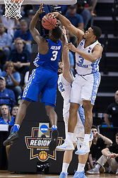 North Carolina forward Kennedy Meeks blocks a shot by Kentucky forward Edrice Adebayo in the second half. North Carolina won 75-73.<br /> <br /> The University of Kentucky hosted the University of North Carolina in a 2017 NCAA D1 Men's South Regional Championship, Sunday, March 26, 2017 at FedExForum in Memphis.
