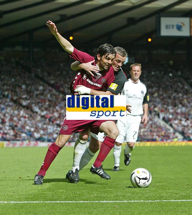 Photo: Andrew Unwin.<br /> Hearts v Gretna. Tennants Scottish Cup Final. 13/05/2006.<br /> Gretna's David Nicholls (R) gets hold of Hearts' Paul Hartley (L).