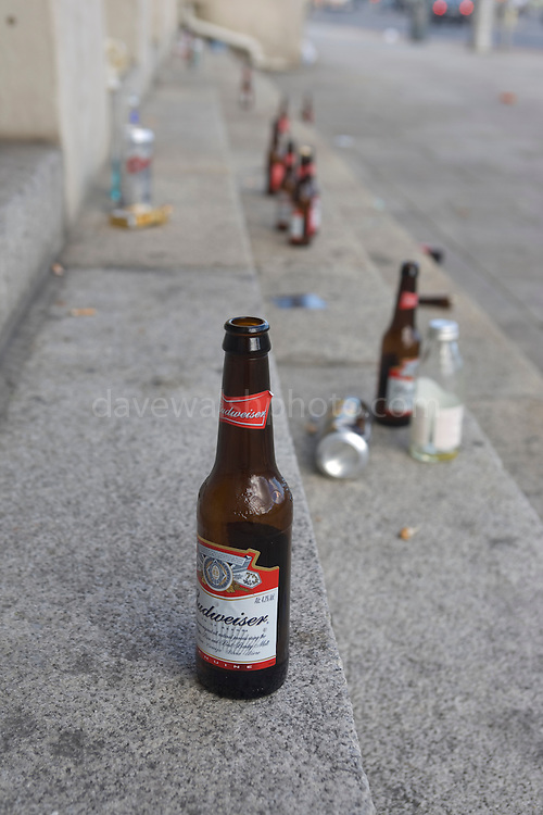 Binge drinking: bottles left on the steps of Dublin city centre landmark, the Customs House on a Saturday afternoon, August 2nd.  ....New laws under the Intoxicating Liquor Act 2008 concerning alcohol consumption came into force on Wednesday July 30th. The new regulations including giving gardai ( police ) more powers to seize alcohol consumed in public earlier off-licence and nightclub closing times and stiffer penalties for those who sell alcohol to under-18s.