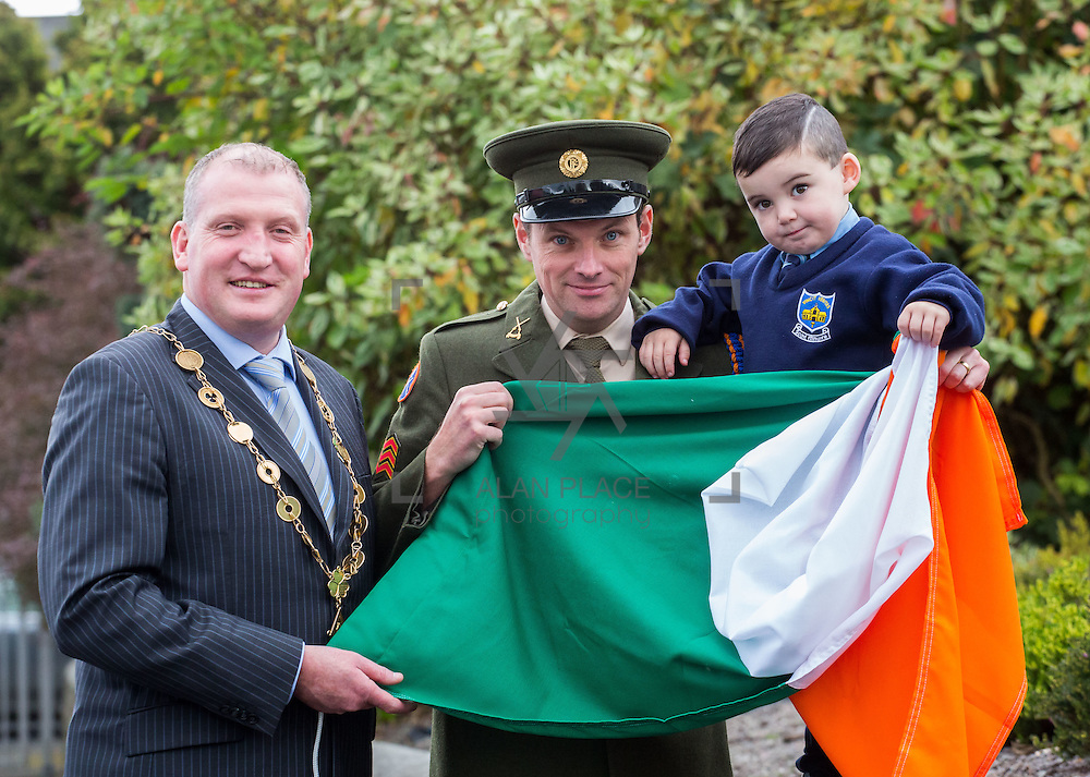23/10/2015       <br /> Members of the Defence Forces were in Abbeyfeale today to present a handmade Tricolour and a copy of the Proclamation of the Irish Republic to students of the town's two primary schools.<br /> <br /> St Marys Boys National School and Scoil Mh&aacute;thair D&eacute; are among 3,000 schools nationally and 152 Limerick primary schools to receive the presentation as part of initiatives to mark the centenary of the 1916 Rising.&nbsp;<br /> <br /> Councillor Liam Galvin, Mayor of the City and County of Limerick joined pupils and teachers for today's presentation ceremony, which saw representatives of the Defences Forces raise the flag and read the Proclamation. <br /> <br /> Attending the ceremony at St. Marys Boys National School were, Mayor of Limerick Cllr. Liam Galvin, Sergeant James Reddan handing over the Tricolur to 4 year old pupil Dillon O'Brien.  Picture: Alan Place.