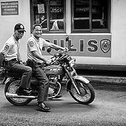 Two of Manila's Finest on the back of a motorcycle