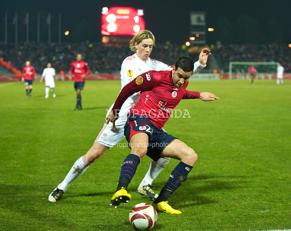 LILLE, FRANCE - Thursday, March 11, 2010: Liverpool's Fernando Torres and LOSC Lille Metropole's Adil Rami during the UEFA Europa League Round of 16 1st Leg match at the Stadium Lille-Metropole. (Photo by David Rawcliffe/Propaganda)