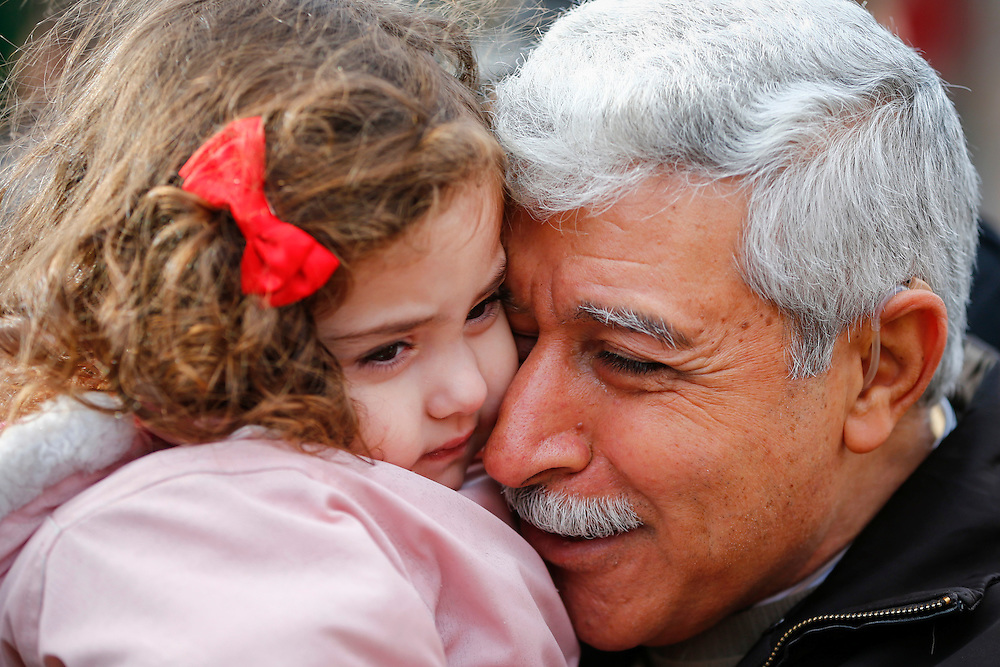 Hagop Manushian, a Syrian refugee who arrived earlier in the morning, is reunited with his granddaughter Rita at the Armenian Community Centre of Toronto, in Mississauga, Ontario, December 11, 2015.