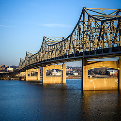 Peoria Illinois Bridge - Photo of Murray Baker Bridge in Peoria Illinois. The Murray Baker Bridge spans the Illinois River connecting Peoria with East Peoria as Interstate I-74. Built in 1958, the bridge is named after Murray Baker who started a company that would later become Caterpillar.