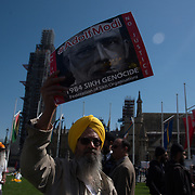 Entire  Indian community from London Protesters chant Modi Go back, Indian army go back, Modi and Indian srmy is a terrorists as Londons Kashmiri community demonstrates at Parliament Square on April 18, 2018. The demonstrators denounced Indian war crimes against Kashmiri people, rejected the presence of Indian Prime Minister Narendra Modi in the United Kingdom, and protested the rape and murder of an 8-year-old Muslim child.