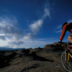 Moab, UT.Mountain biking on the Moab Slickrock Bike Trail.  Navajo Sandstone.  BLM land.  La Sal Mountains in background.