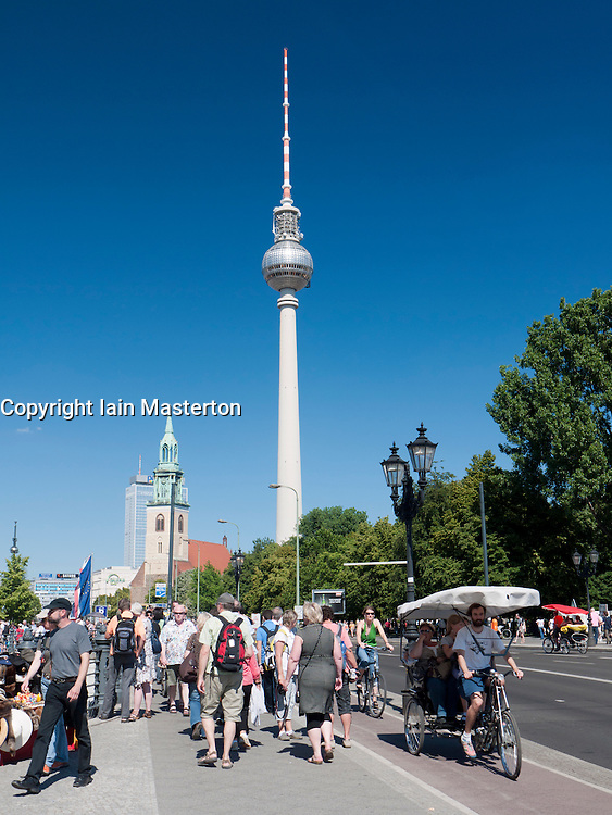 Busy street with Fernsehturm or Television Tower to rear in Alexanderplatz in Mitte Berlin Germany