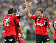 Sonny Bill Williams and Israel Dagg celebrate Wyatt Crockett's try..Investec Super Rugby - Highlanders v Crusaders, 19 March 2011, Carisbrook Stadium, Dunedin, New Zealand..Photo: Rob Jefferies / www.photosport.co.nz