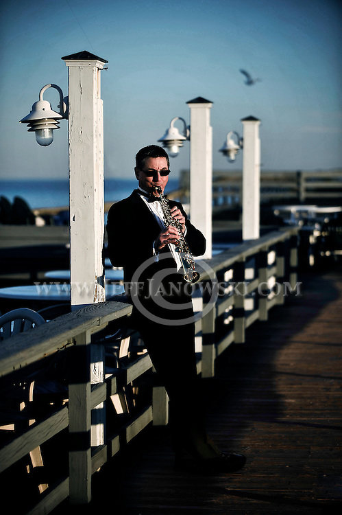 Wilmington musical performer, David Key, a Therapeutic Sound Artist, plays on the Oceanic Pier in Wrightsville Beach, North Carolina.