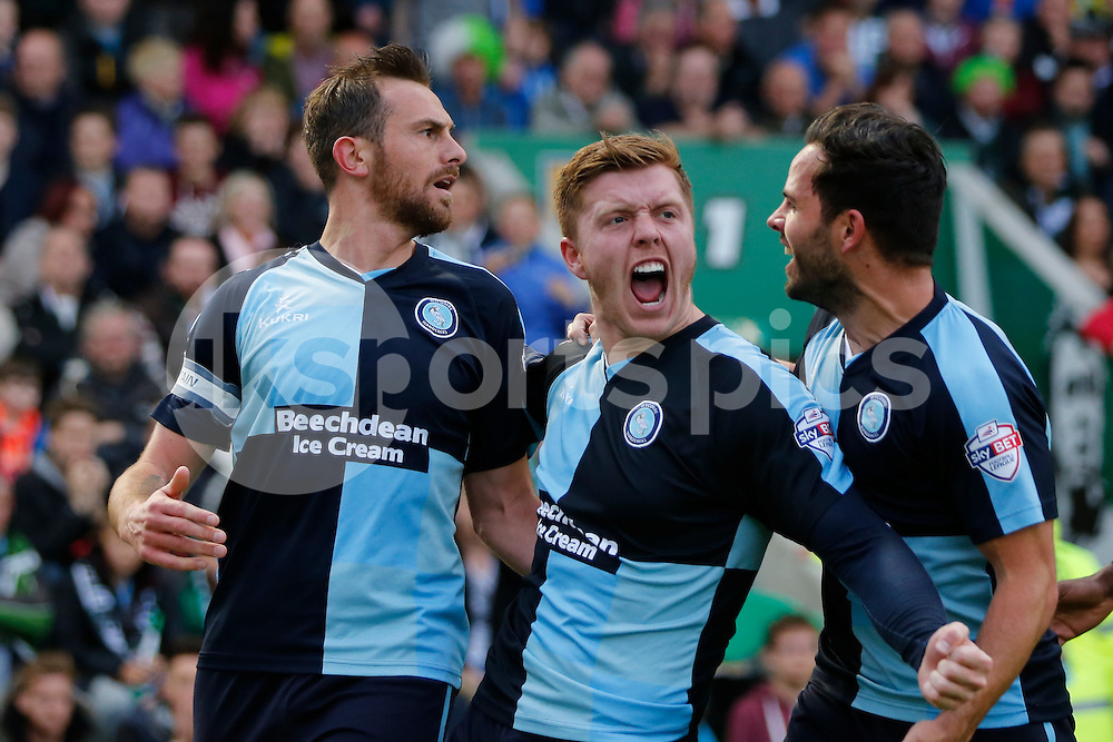 Paul Hayes of Wycombe Wanderers (left) celebrates scoring his side's first goal with Alfie Mawson and Sam Wood during the Sky Bet League 2 Play Off 1st Leg match between Plymouth Argyle and Wycombe Wanderers at Home Park, Plymouth, England on 9 May 2015. Photo by Mark Hawkins.