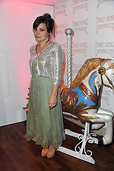 LILY ALLEN at a party to celebrate the launch of the Lucy in Disguise Ready to Wear collection exclusive to Harvey Nichols, held at The Fifth Floor Restaurant, Harvey Nichols, Knightsbridge, London on 25th May 2011.