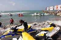 Jet ski competition in Iran.Khezer Shahr, Iran. August 30, 2007- A man checks his jet ski before a competition.
