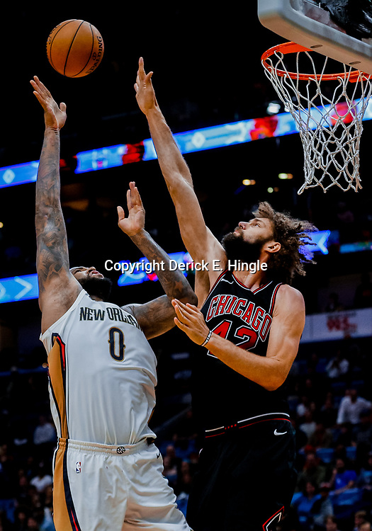 Jan 22, 2018; New Orleans, LA, USA; New Orleans Pelicans center DeMarcus Cousins (0) shoots over Chicago Bulls center Robin Lopez (42) during double overtime at the Smoothie King Center. The Pelicans defeated the Bulls 132-128 in double overtime. Mandatory Credit: Derick E. Hingle-USA TODAY Sports