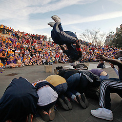 January 8, 2012; New Orleans, LA, USA;  Street performers Dragon Masters perform for a crowd of fans in the French Quarter following the Fan Fest pep rally for the 2012 BCS National Championship game to be played on January 9, 2012 between the Alabama Crimson Tide and the LSU Tigers at the Mercedes-Benz Superdome.  Mandatory Credit: Derick E. Hingle-USA TODAY SPORTS