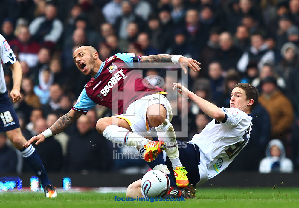 Picture by John Rainford/Focus Images Ltd. 07506 538356.04/02/12.Julien Faubert of West Ham United and Shane Lowry of Millwall during the Npower Championship match at The Boleyn Ground, London.