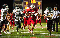 Bradley Weeks breaks through Pembroke's defense during Friday night's Homecoming football game under the lights at LHS.  (Karen Bobotas/for the Laconia Daily Sun)