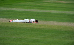 Dejection for Somerset's Jamie Overton. Photo mandatory by-line: Harry Trump/JMP - Mobile: 07966 386802 - 24/05/15 - SPORT - CRICKET - LVCC County Championship - Division 1 - Day 1- Somerset v Sussex Sharks - The County Ground, Taunton, England.