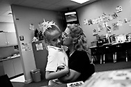 OT_282486_LYTT_LDDANI<br /> <br /> CAPTION:  (TAMPA, FL -- 02/03/2008) &quot;It's like she knows she's leaving soon, once school gets out,&quot; said speech language pathologist Leslie Goldenberg, who was pleasantly surprised by Dani's spontaneous act of affection.  After Dani sat in Goldenberg's lap for a while, studying her face and hugging her, Goldenberg gives Dani a big kiss on the cheek.  &quot;I'm going to miss you, too.  More than you know.&quot;  (MELISSA LYTTLE | Times)<br /> <br /> STORY SUMMARY:  For the first seven years of her life, Danielle never saw the sun, felt the wind or tasted solid food.  She was kept in a closet in a Plant City apartment, cloistered in darkness, left in a dirty diaper, fed only with a bottle. &quot;She was a ferral child,&quot; said Carolyn Eastman of the Tampa heart Gallery. &quot;We'd never seen a case like that.&quot;