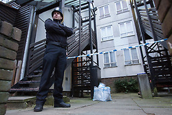 © licensed to London News Pictures. London, UK 08/01/2013. Police officers waiting outside the Streatham flat where the body of 23-year-old Anastasia Voykina was found. Felipe Lopes (not pictured), aged 27, who was in a relationship with the woman, was seen on the 5 January in the Piccadilly area of central London, and is being searched for by police in connection to the death. Police have put out an all ports and airports alert for 27-year-old Mr Lopes, a Portugese national. Photo credit: Tolga Akmen/LNP
