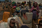 KYANGWALI REFUGEE CAMP, UGANDA - MARCH 23: Congolese refugees wait at a reception center to be assigned to a specific area in Kyangwali refugee resettlement camp in Uganda on March 23, 2018. Some refugees will have to stay here for multiple days while being assigned to a specific area of the camp. Violence in Ituri Province in northeastern Democratic Republic of Congo has displaced more than 100,000 people including approximately 40,000 refugees who have fled to Uganda. (Photo by Andrew Renneisen for The Washington Post)