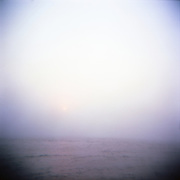 """One early morning offshore Rhode Island, as the sun peaks through the fog.  I was shooting with film and was equipped with the cult classic medium format plastic """"toy"""" Holga camera.  Stripped of over complicated controls, this camera just allows you to focus on composition and snap away."""