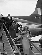 08/06/1957<br /> 06/08/1957<br /> 08 June 1957<br /> <br /> Herbert Wilcox and Anna Neagle arriving at Dublin Airport<br /> <br /> <br /> Dame Anna Neagle, DBE (20/10/1904 &ndash; 03/06/1986), born Florence Marjorie Robertson, was a popular British stage and motion picture actress and singer.<br />