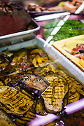 Sliced, grilled, and chilled eggplants in olive oil, Mercato Centrale, Florence, Italy