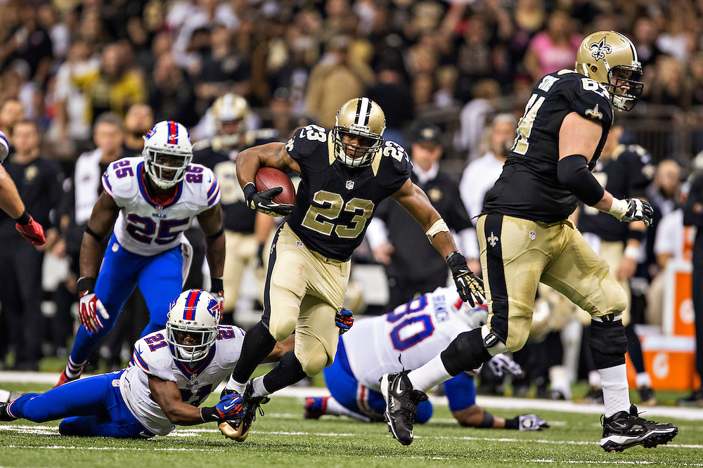 NEW ORLEANS, LA - OCTOBER 27:  Pierre Thomas #23 of the New Orleans Saints is grabbed by Leodis McKelvin #21 of the Buffalo Bills at Mercedes-Benz Superdome on October 27, 2013 in New Orleans, Louisiana.  The Saints defeated the Bills 35-14.  (Photo by Wesley Hitt/Getty Images) *** Local Caption *** Pierre Thomas; Leodis McKelvin