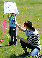 Andrew Kanavy, 6 of Plymouth Meeting, Pennsylvania get help from his mother Laura Kanavy as they fly a kite during Kite Day Sunday April 24, 2016 at the Fonthill Museum in Doylestown, Pennsylvania. (Photo by William Thomas Cain/Cain Images)