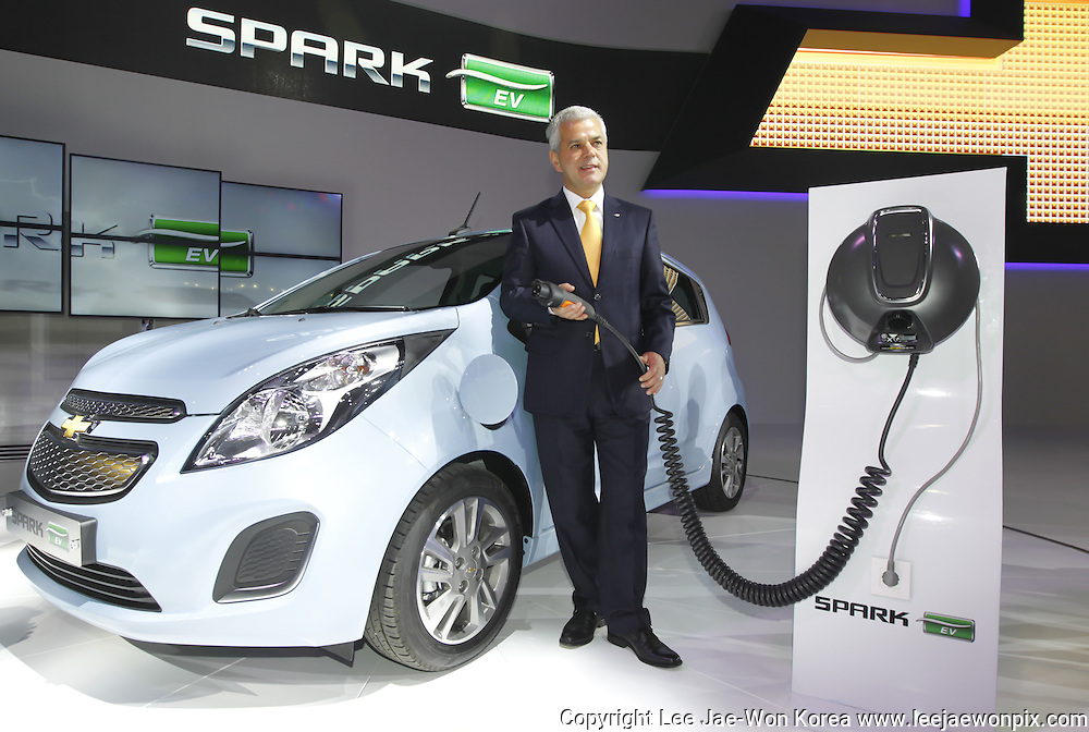 Sergio Rocha, president and CEO of GM Korea poses next to Spark EV at the Seoul motor show in Goyang, north of Seoul March 28, 2013. Photo by Lee Jae-Won (SOUTH KOREA)  www.leejaewonpix.com