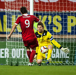Falkirk's keeper Michael McGovern saves from Scott Vernon. Falkirk 0 v 5 Aberdeen, the third round of the Scottish League Cup.<br /> &copy;Michael Schofield.