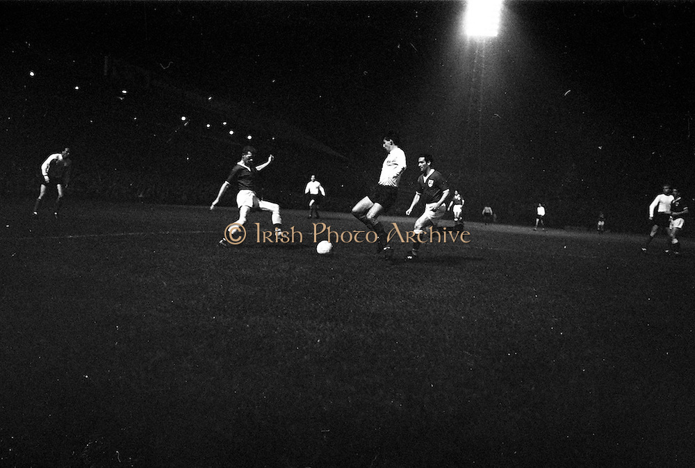 02/10/1963<br /> 10/02/1963<br /> 02 October 1963<br /> League of Ireland v English Football League at Dalymount Park, Dublin. Martin Peters (England, West Ham) clears his lines under pressure from Irish forwards, Peter Fitzgerald (Waterford) (left) and Eddie Bailham (Shamrock Rovers).