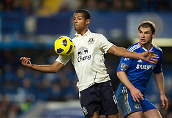 LONDON, ENGLAND - Saturday, December 4, 2010: Everton's Jermaine Beckford and Chelsea's Branislav Ivanovic during the Premiership match at Stamford Bridge. (Pic by: David Rawcliffe/Propaganda)