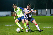 Maidenhead United forward Josh Kelly tussles with Havant & Waterlooville defender Tyler Cordner during the Vanarama National League match between Maidenhead United and Havant & Waterlooville FC at York Road, Maidenhead, United Kingdom on 26 March 2019.