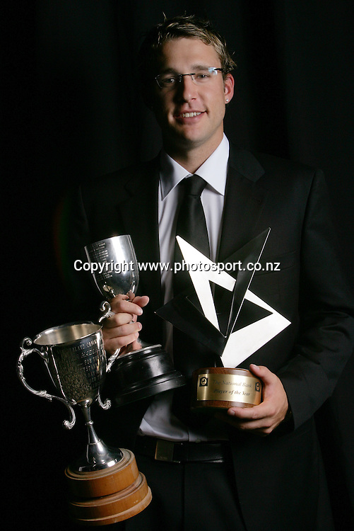 Daniel Vettori with his three trophies - The Winsor Cup, (awarded to the bowler whose performances in men&Iacute;s first class cricket have been the most meritorious) The Walter Hadlee Trophy, (awarded for the most meritorious bowling by a New Zealand player in One Day Internationals) and The Player of the Year trohpy at the National Bank New Zealand Cricket Awards, Langham Hotel, Auckland, New Zealand on Thursday 31 March, 2005. Photo: Hannah Johnston/PHOTOSPORT<br />