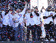 Cubs players celebrate during their World Series championship rally Friday at Grant Park in Chicago.