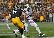 November 12, 2011: Michigan State Spartans running back Edwin Baker (4) eyes Iowa Hawkeyes defensive back Tanner Miller (5) on a run during the second half of the NCAA football game between the Michigan State Spartans and the Iowa Hawkeyes at Kinnick Stadium in Iowa City, Iowa on Saturday, November 12, 2011. Michigan State defeated Iowa 37-21.