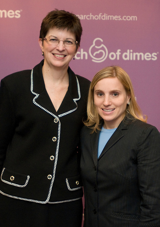 DISTRICT OF COLUMBIA: Oct. 8, 2009 - Olympic gold medalist Kerri Strug poses with an attendee of a Library of Congress event, Thursday, October 8 at a reception to kick off the March of Dimes fundraising efforts for 2010, the organization honored special volunteers and announced the first-ever March for Babies National Co-chairs, Alan Mulally, President and CEO of Ford Motor Company and Ron Gettelfinger, President of United Auto Workers. Strug received the Volunteer Leadership award for helping to raise public awareness of the cause. Photo by Johnny Bivera..