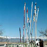 12 April 1976<br /> Kabul. Shrine of Pacha Sahib (Tajik). A number of people around the shrine. Snow mountain in the background.