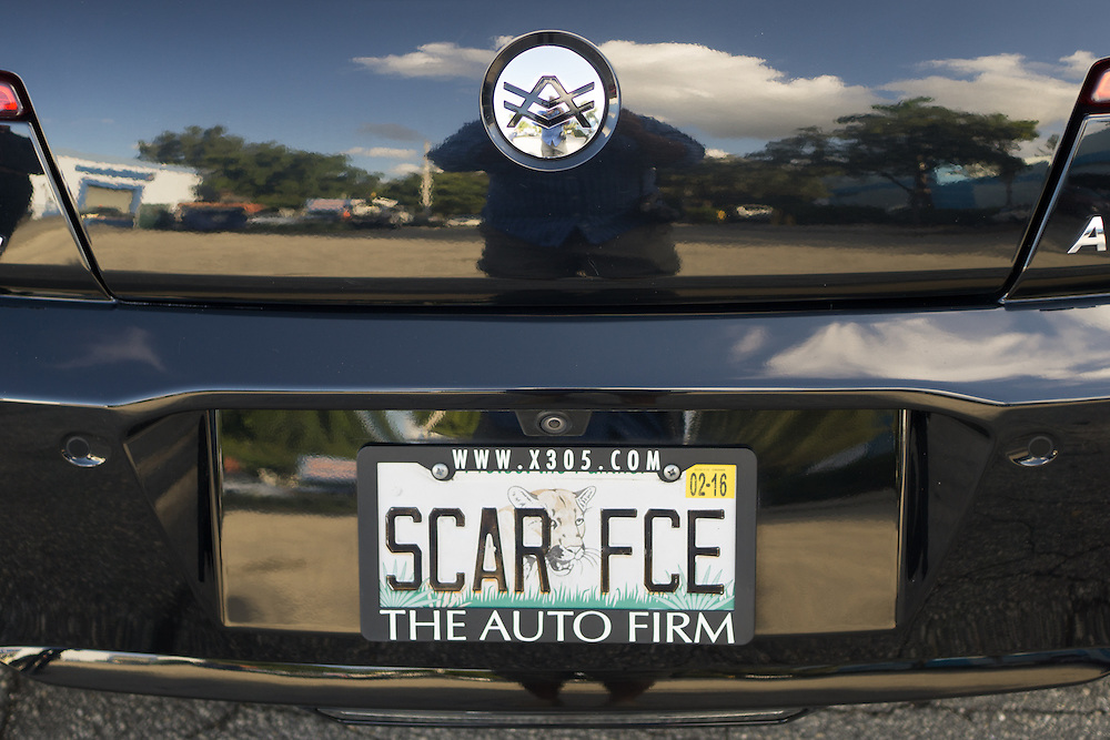 DORAL, FLORIDA, DECEMBER 11, 2015<br /> The personalized plate on the Fisker Karma of Alex Vega, owner of The Auto Firm, a South Florida car customizing and restoring shop which has a vast clientele of professional athletes and entertainers. His office walls are full of mementos given to him and signed by his clients.<br /> (Photo by Angel Valentin/Freelance)