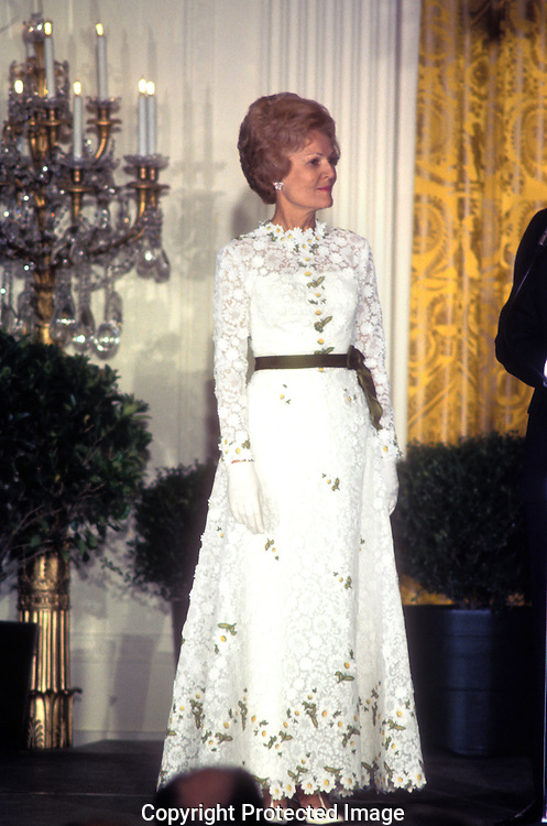 . First Lady Pat Nixon stands in the steps  of the Grand foyer of the White House at the wedding of Trica Nixon and Ed Cox in the White House on June 12, 1971..Photograph by Dennis Brack  BS B 15