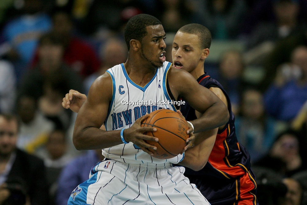 Dec 23, 2009; New Orleans, LA, USA; New Orleans Hornets guard Chris Paul (3) is guarded by Golden State Warriors guard Stephen Curry (30) during second half at the New Orleans Arena. The Hornets defeated the Warriors 108-102. Mandatory Credit: Derick E. Hingle-US PRESSWIRE
