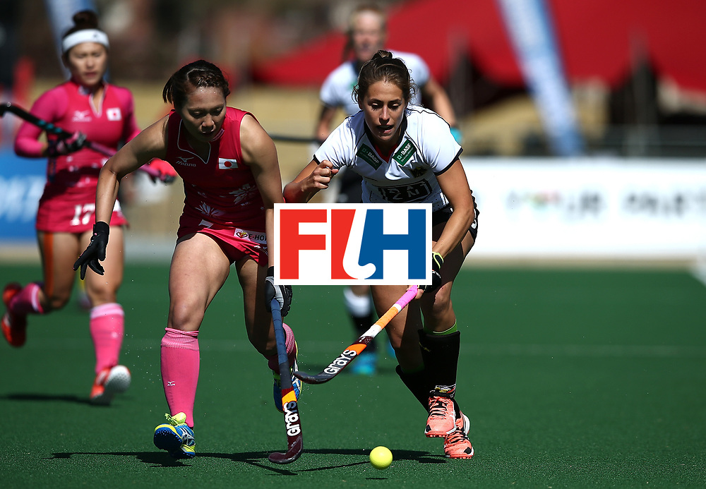 JOHANNESBURG, SOUTH AFRICA - JULY 16:  Marie Mavers of Germany battles with Mami Ichitani of Japan during day 5 of the FIH Hockey World League Women's Semi Finals Pool A match between Japan and Germany at Wits University on July 16, 2017 in Johannesburg, South Africa.  (Photo by Jan Kruger/Getty Images for FIH)