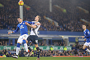 Everton defender Ramiro Funes Mori  and Tottenham Hotspur forward Harry Kane tangle for the ball during the Barclays Premier League match between Everton and Tottenham Hotspur at Goodison Park, Liverpool, England on 3 January 2016. Photo by Simon Davies.