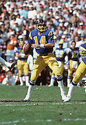 San Diego Chargers quarterback Dan Fouts (14) throws a pass during the NFL football game AFC Divisional Playoff  between the San Diego Chargers and the Miami Dolphins in San Diego California on January 16, 1983. The Dolphins won the game 34-13. ©Paul Anthony Spinelli