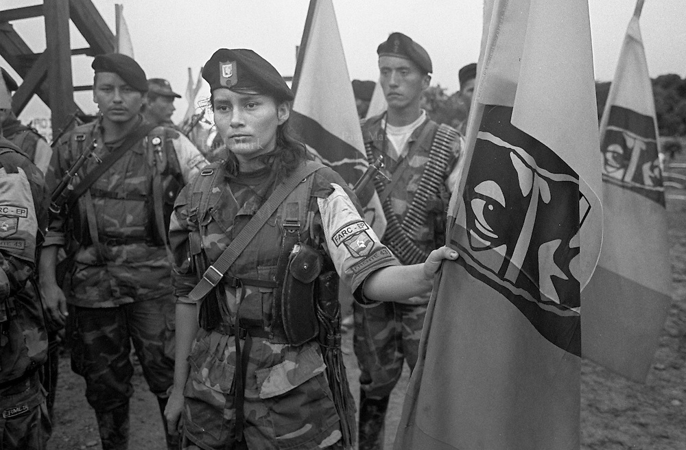 FARC (Revolutionary Armed Forces of Colombia) guerrillas with flags of the Boliviarian movement.