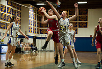 Belmont's Jordan Sargent goes up for a shot with pressure from Gilford's Hannah Perkins during NHIAA division III basketball Friday evening.  (Karen Bobotas/for the Laconia Daily Sun)