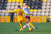 Jack McMillan (#21) of Livingston FC tackles Aaron Hickey (#51) of Heart of Midlothian FC during the Ladbrokes Scottish Premiership match between Livingston FC and Heart of Midlothian at the Tony Macaroni Arena, Livingston, Scotland on 26 October 2019.